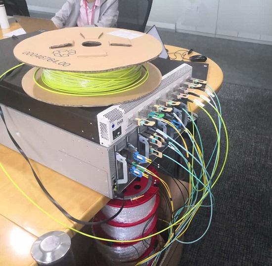 腾讯完成国内首次多厂商400G光模块、交换机组网互通性能测试